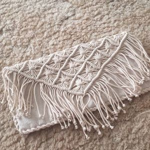 Cream tassel clutch